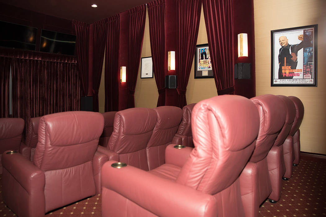 There's a 12-seat home theater with a 150-inch screen and a curtain. (Tonya Harvey Real Estate Millions)