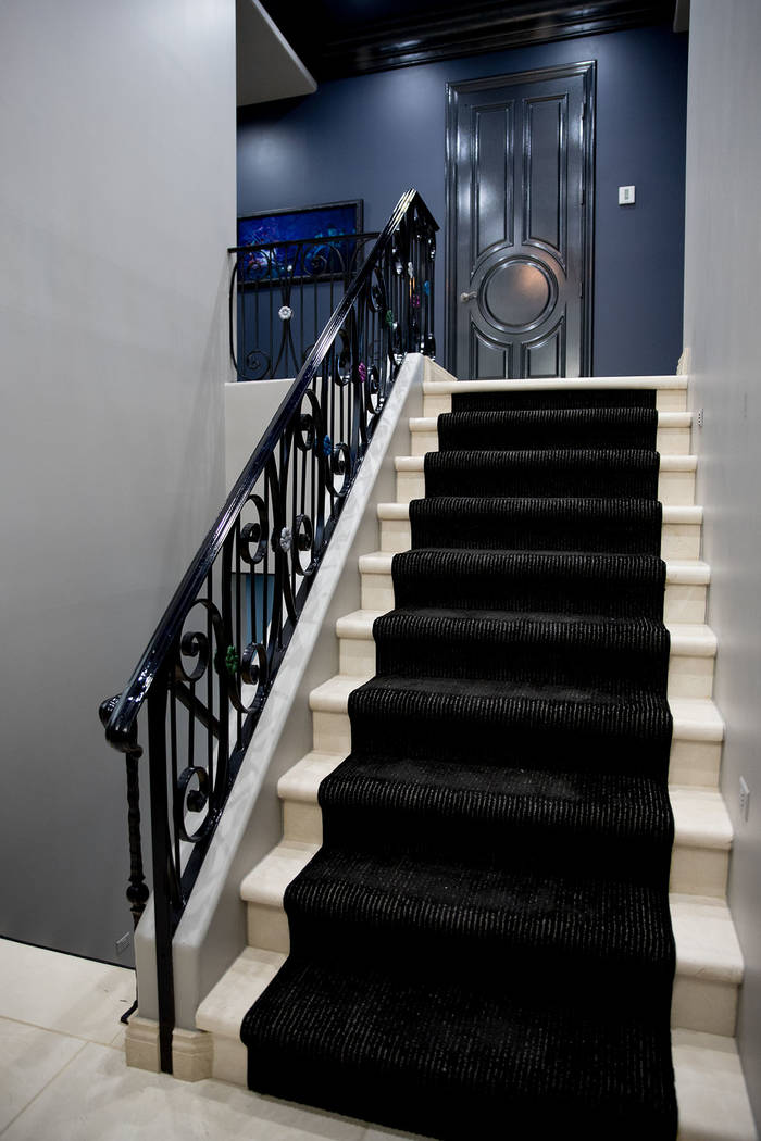 The staircase leads to two bedrooms and the game room upstairs. (Tonya Harvey Real Estate Millions)