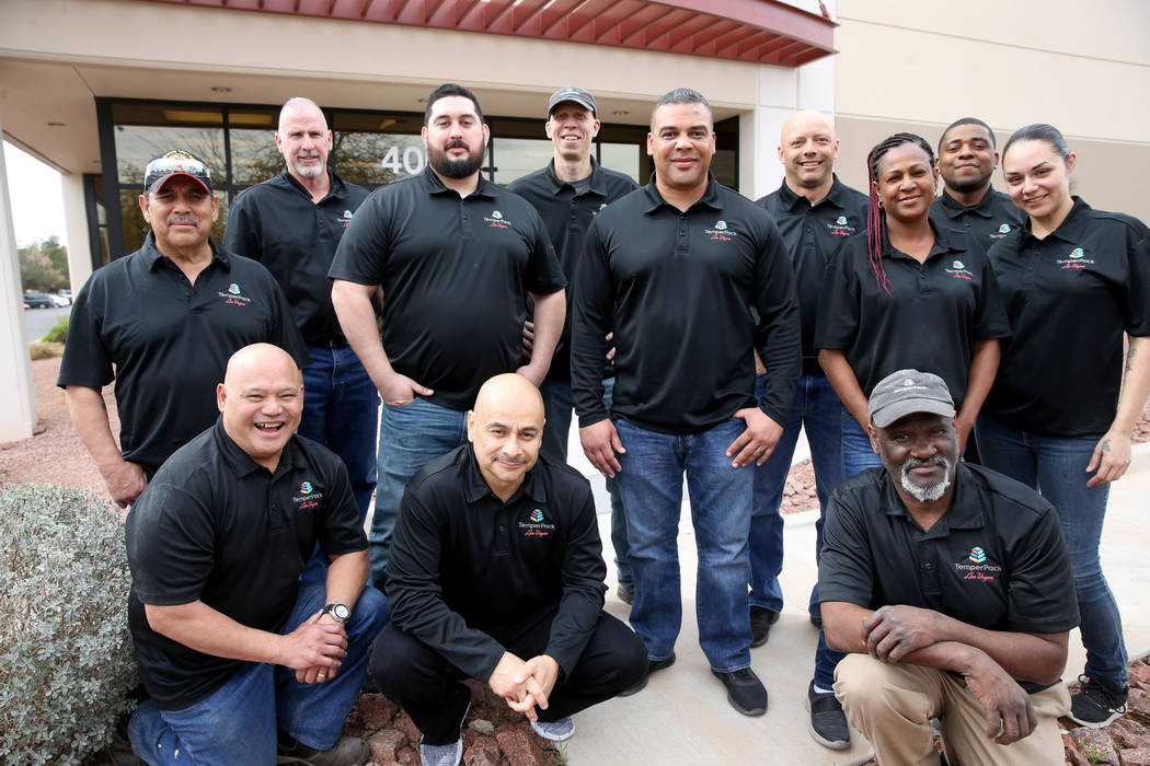 The TemperPack team at their Las Vegas office Wednesday, March 20, 2019. Kneeling from left are Ron Batula, safety manager, Victor Pineda, production manager, and Bill Ellick, facilities maintenan ...