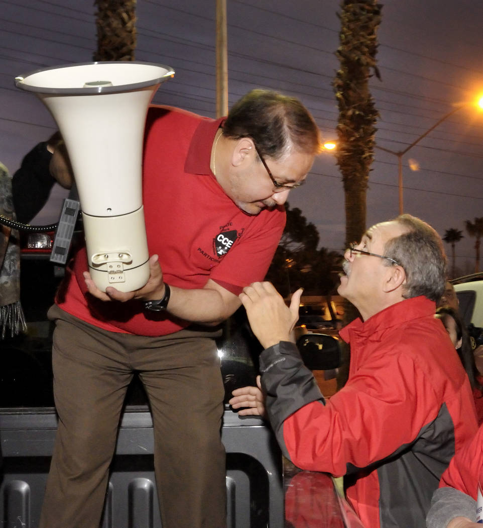 Clark County Education Association President Ruben Murillo, left, confers with CCEA Director John Vellardita during a rally outside the Edward Greer Education Center at 2832 E. Flamingo Road on Th ...