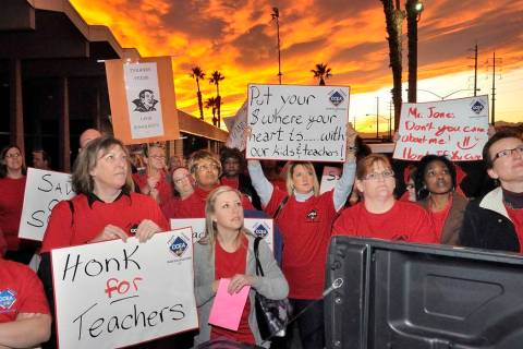 Clark County Education Association supporters listen to CCEA union president Ruben Murillo during a rally outside the Edward Greer Education Center at 2832 E. Flamingo Road on Thursday, Jan. 26, 2 ...