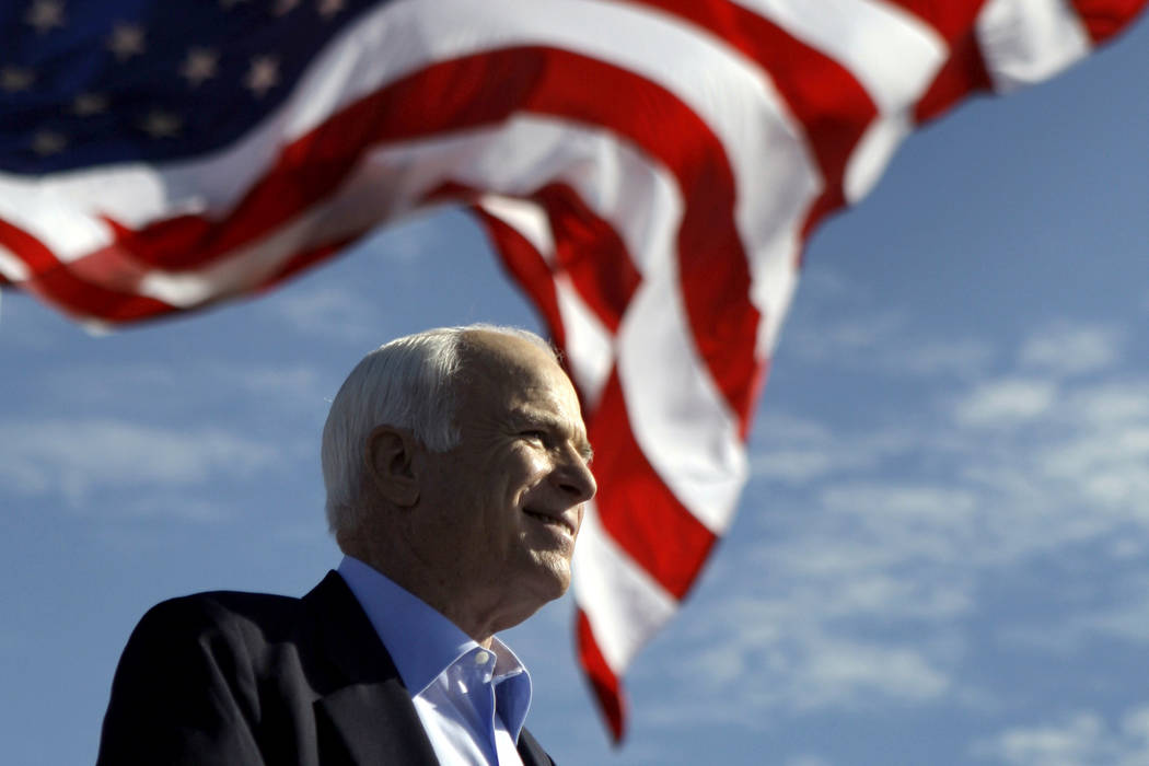 FILE - In this Nov. 3, 208 file photo, Republican presidential candidate Sen. John McCain, R-Ariz. speaks at a rally outside Raymond James Stadium in Tampa, Fla. President Donald Trump is not back ...