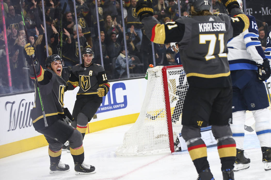 Golden Knights center Jonathan Marchessault, left, celebrates a goal by Golden Knights center William Karlsson (71) as Golden Knights right wing Reilly Smith (19) looks on during the first period ...