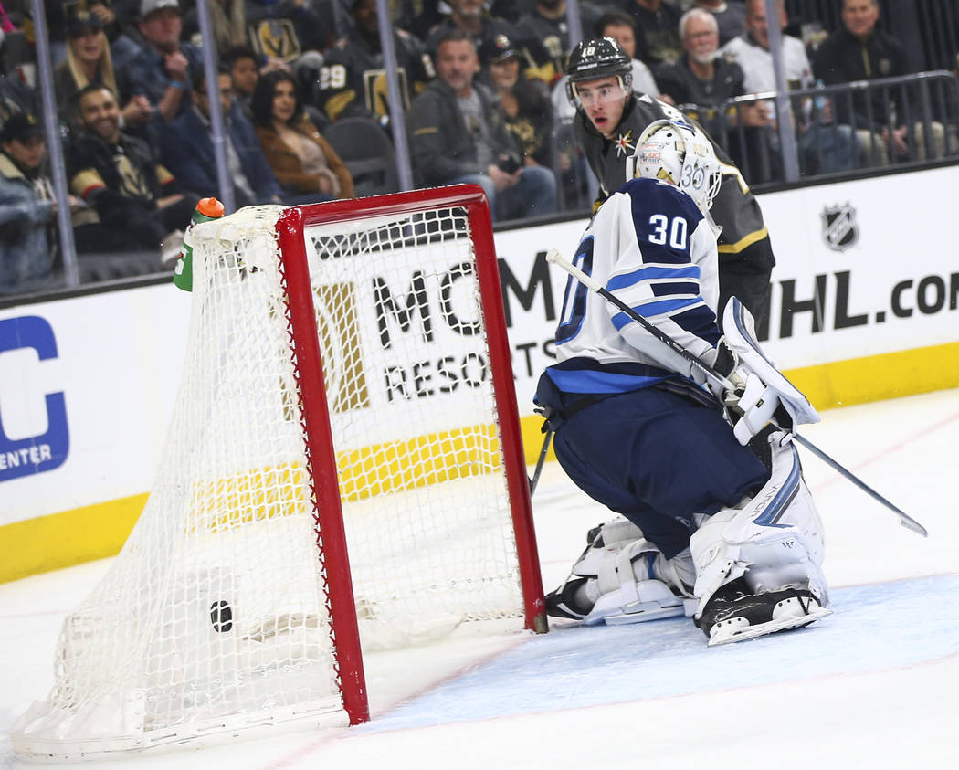 Golden Knights right wing Reilly Smith (19) scores past Winnipeg Jets goaltender Laurent Brossoit (30) during the first period of an NHL hockey game at T-Mobile Arena in Las Vegas on Thursday, Mar ...