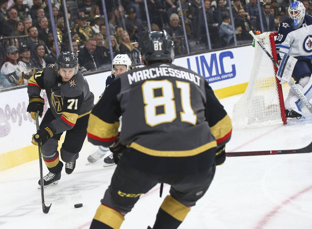 Golden Knights center William Karlsson (71) lines up the puck before taking a shot to score against Winnipeg Jets goaltender Laurent Brossoit (30) during the first period of an NHL hockey game at ...