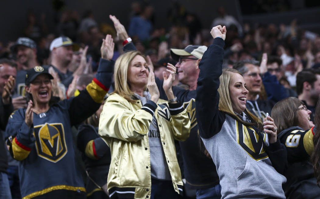 Golden Knights fans celebrate a goal by Golden Knights center William Karlsson, not pictured, during the first period of an NHL hockey game against the Winnipeg Jets at T-Mobile Arena in Las Vegas ...