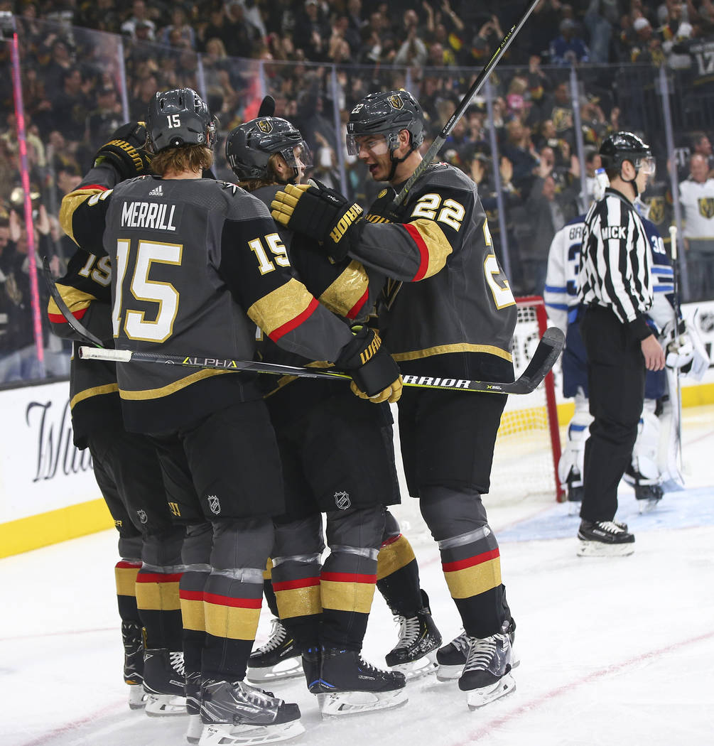 Golden Knights players celebrate their first goal against the Winnipeg Jets during the first period of an NHL hockey game at T-Mobile Arena in Las Vegas on Thursday, March 21, 2019. (Chase Stevens ...