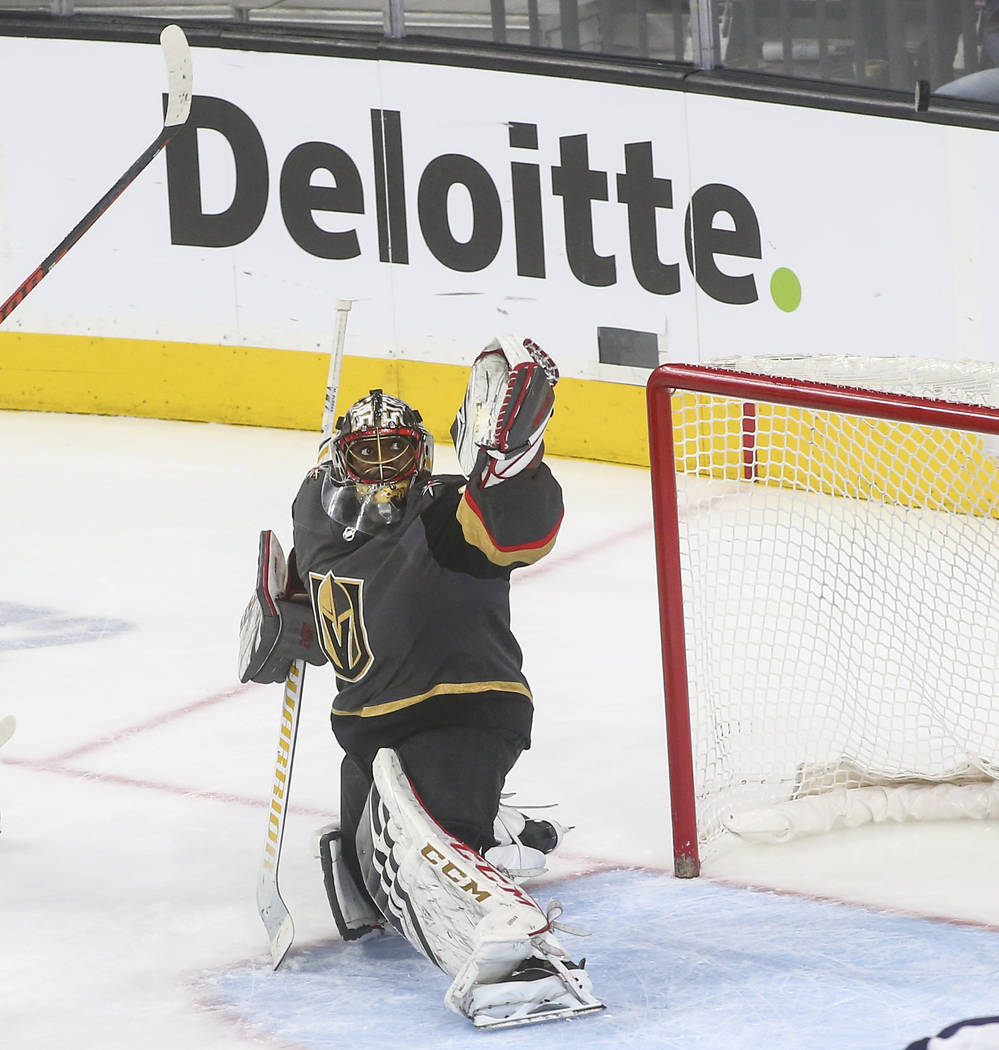 Golden Knights goaltender Malcolm Subban (30) watches the puck fly over during the third period of an NHL hockey game against the Winnipeg Jets at T-Mobile Arena in Las Vegas on Thursday, March 21 ...