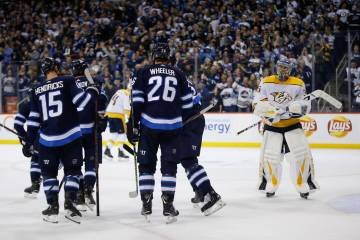 Winnipeg Jets celebrate Andrew Copp's (9) goal as Nashville Predators goaltender Pekka Rinne (35) look on during the second period of an NHL hockey game, Saturday, March 23, 2019 in Winnipeg, Mani ...