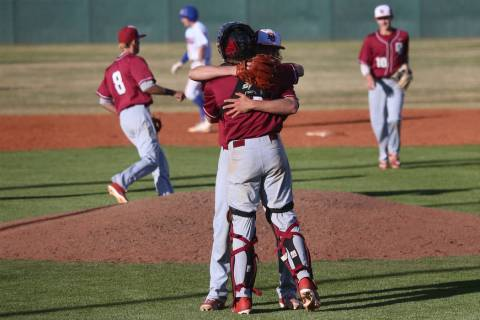 Desert Oasis pitcher Josh Sharman (11) hugs teammate Parker Schmidt (4) after getting the last out of the game to win 4-0 against Bishop Gorman in the baseball game at Bishop Gorman High School in ...