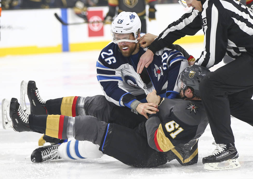 Winnipeg Jets right wing Blake Wheeler (26) fights Golden Knights right wing Mark Stone (61) during the first period of an NHL hockey game at T-Mobile Arena in Las Vegas on Thursday, March 21, 201 ...