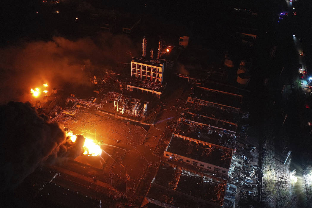 In this Thursday, March 21, 2019, aerial photo released by China's Xinhua News Agency, fires burn at the site of a factory explosion in a chemical industrial park in Xiangshui County of Yancheng i ...