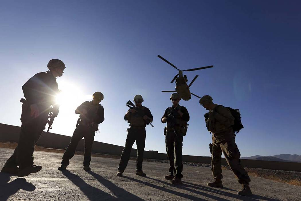 FILE - In this Nov. 30, 2017 file photo, American soldiers wait on the tarmac in Logar province, Afghanistan. The longest direct talks ever held between the United States and the Taliban concluded ...