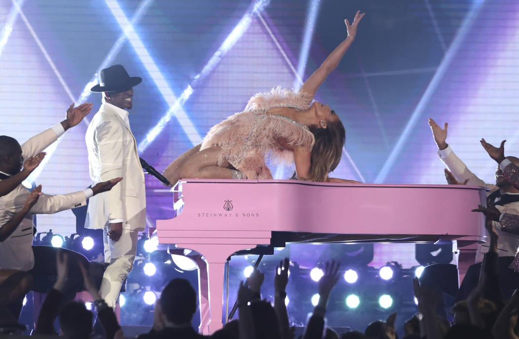 Ne-Yo, left, and Jennifer Lopez perform a medley during a tribute to Motown's 60th anniversary at the 61st annual Grammy Awards on Sunday, Feb. 10, 2019, in Los Angeles. (Matt Sayles/Invision/AP)