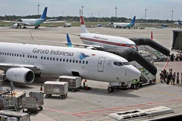 In this April 28, 2017, file photo, Garuda Indonesia planes are parked on the apron at the Soekarno-Hatta International Airport in Tangerang, Indonesia. Indonesia's flag carrier is seeking the can ...