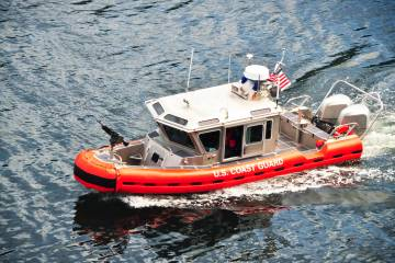 A US Coast Guard boat patrols the ocean. (Getty Images)