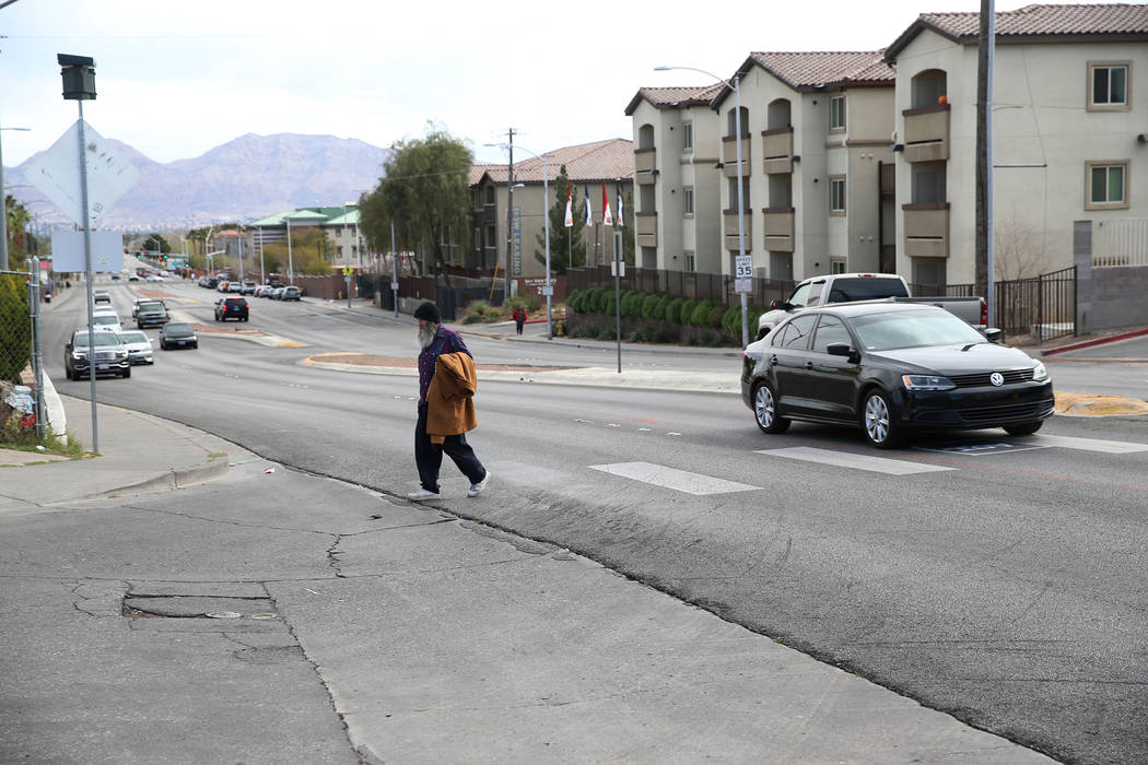 Homeless man Timothy Hamett crosses the intersection of W. Owens Avenue and Stocker Street, across from The Salvation Army, in North Las Vegas, Tuesday, March 12, 2019. Hamett witnessed a fatal pe ...