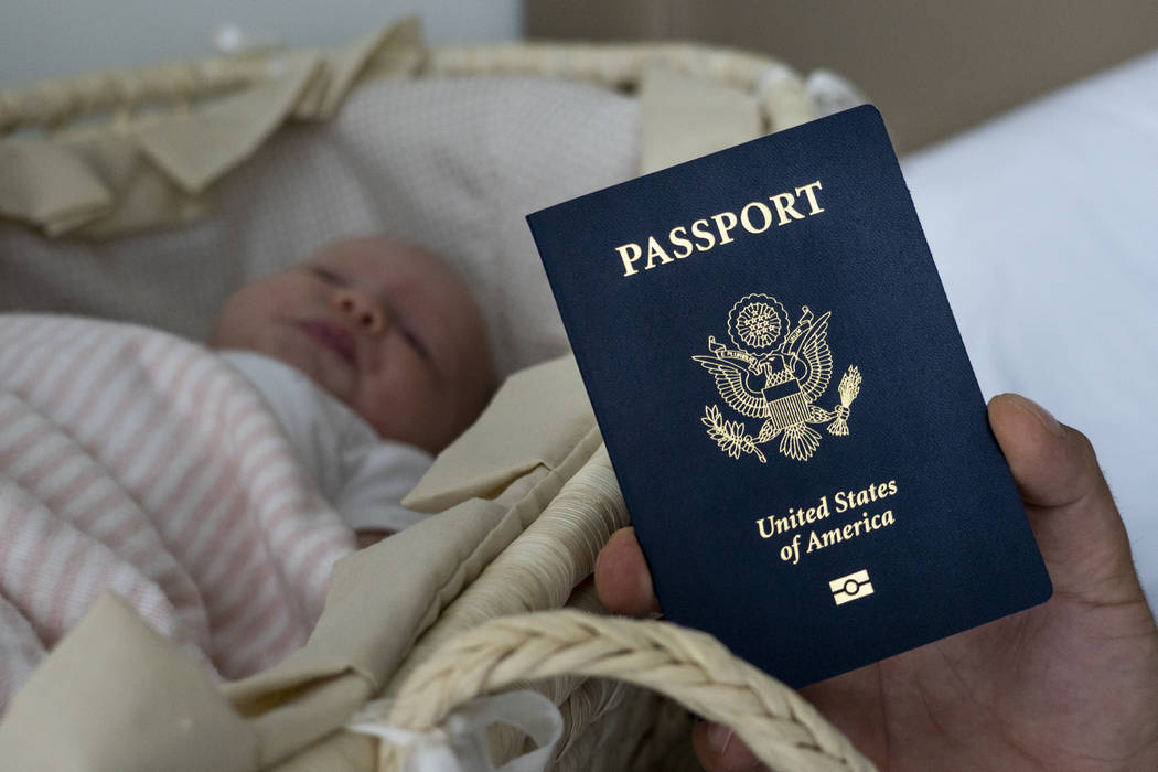 In this photo taken on Jan. 24, 2019, Denis Wolok, the father of 1-month-old Eva's father, shows the child's U.S. passport during an interview with The Associated Press in Hollywood, Fla. Every ye ...