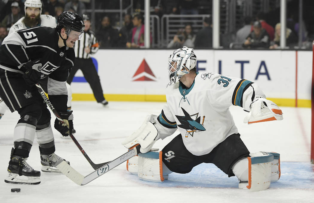 Los Angeles Kings left wing Austin Wagner, left, tries to get a shot past San Jose Sharks goaltender Martin Jones during the second period of an NHL hockey game Thursday, March 21, 2019, in Los An ...