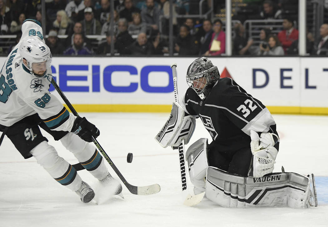 San Jose Sharks center Melker Karlsson, left, tries to get a shot past Los Angeles Kings goaltender Jonathan Quick during the third period of an NHL hockey game Thursday, March 21, 2019, in Los An ...