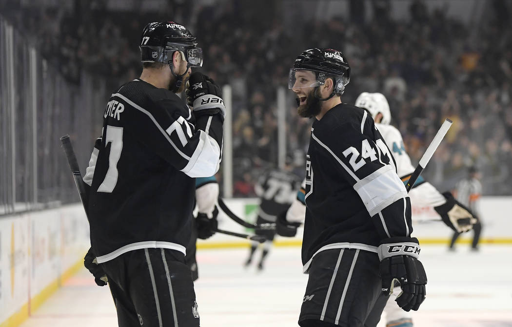 Los Angeles Kings center Jeff Carter, left, celebrates his empty-net goal with defenseman Derek Forbort during the third period of the team's NHL hockey game against the San Jose Sharks on Thursda ...