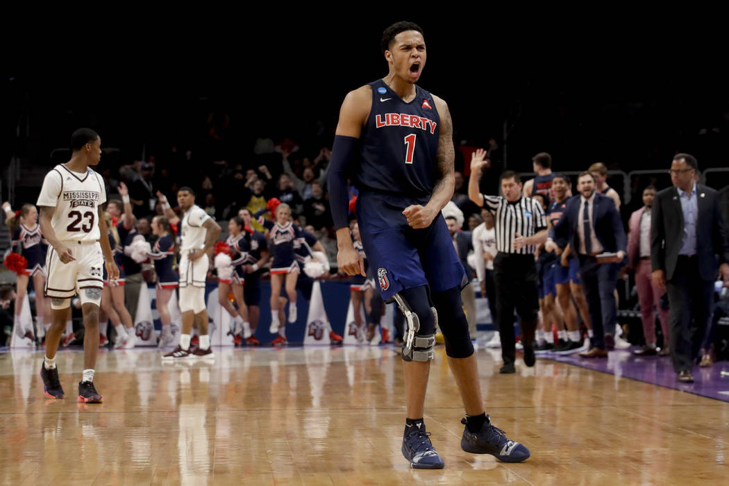 Liberty guard Caleb Homesley celebrates after scoring against Mississippi State during the second half of a first-round game in the NCAA men's college basketball tournament Friday, March 22, 2019, ...