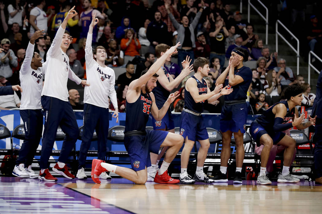 Liberty celebrates during the second half of a first round game against Mississippi State in the NCAA men's college basketball tournament Friday, March 22, 2019, in San Jose, Calif. (AP Photo/Ben ...