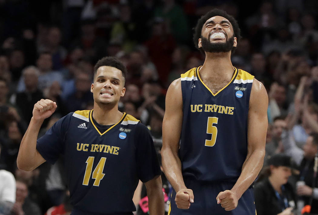 UC Irvine guard Evan Leonard (14) and forward Jonathan Galloway (5) celebrate after they defeated Kansas State in a first round men's college basketball game in the NCAA Tournament, Friday, March ...