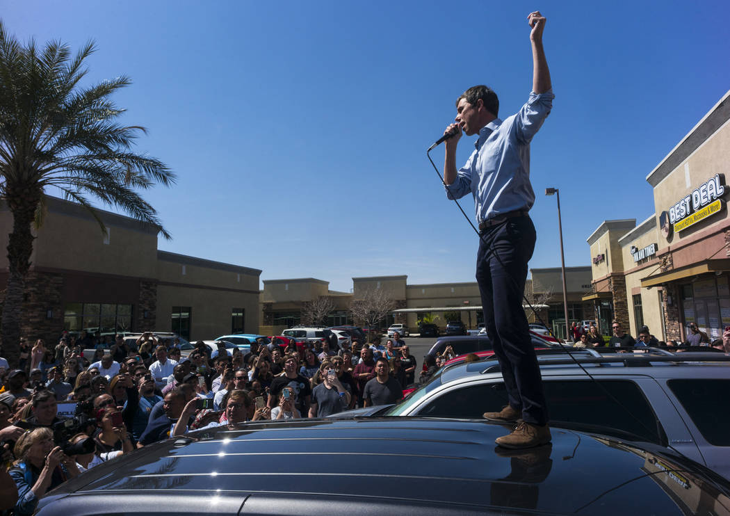 Democratic presidential candidate and former Texas congressman Beto O'Rourke acknowledges the crowd after arriving at a campaign stop at Pour Coffeehouse in Las Vegas on Sunday, March 24, 2019. (C ...
