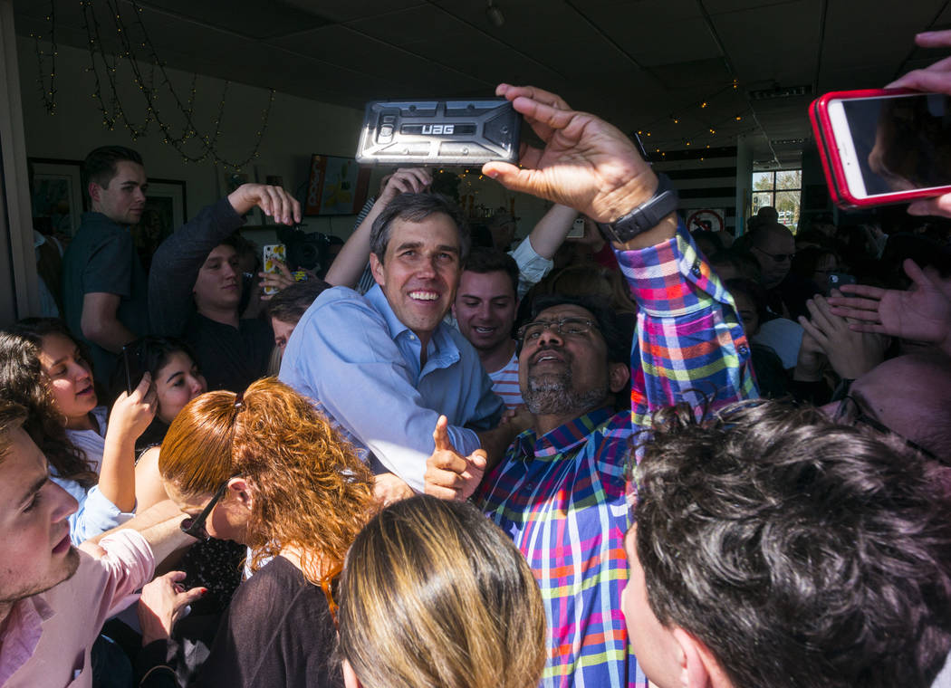 Democratic presidential candidate and former Texas congressman Beto O'Rourke takes pictures with supporters during a campaign stop at Pour Coffeehouse in Las Vegas on Sunday, March 24, 2019. (Chas ...