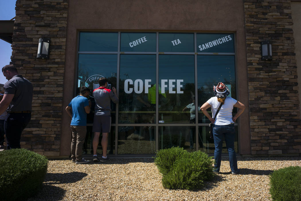 An overflow crowd listens to Democratic presidential candidate and former Texas congressman Beto O'Rourke, not pictured, speak during a campaign stop at Pour Coffeehouse in Las Vegas on Sunday, Ma ...