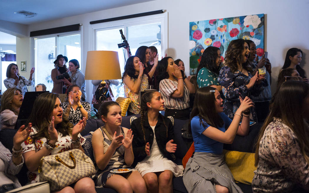 Members of the Mujeres Network cheer as Democratic presidential candidate and former Texas congressman Beto O'Rourke, not pictured, speaks during a meet and greet event with the Mujeres Network in ...