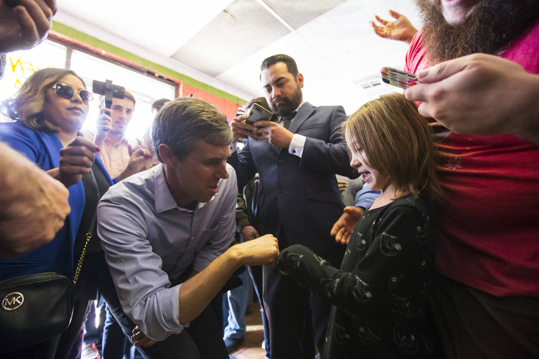 Democratic presidential candidate and former Texas congressman Beto O'Rourke greets a supporter during a campaign stop at Arandas Taqueria in Las Vegas on Sunday, March 24, 2019. (Chase Stevens/La ...