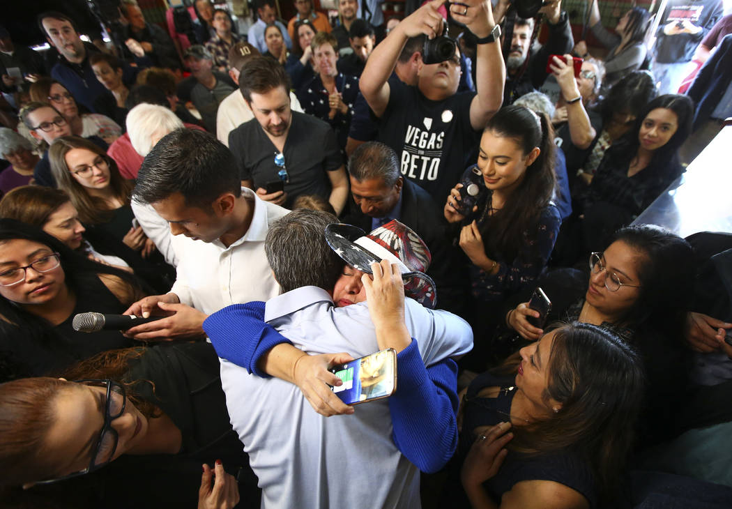 Democratic presidential candidate and former Texas congressman Beto O'Rourke hugs Susy Cazarin, who lost her son to an opioid overdose, during a campaign stop at Arandas Taqueria in Las Vegas on S ...
