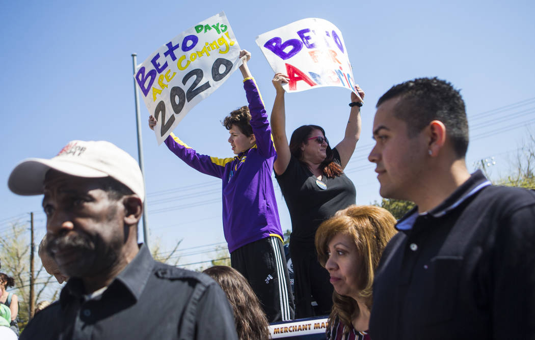 Gabriel Shimel, 11, left, and Angela Shimel hold up signs in support of Democratic presidential candidate and former Texas congressman Beto O'Rourke before he arrived for a campaign event at Pour ...