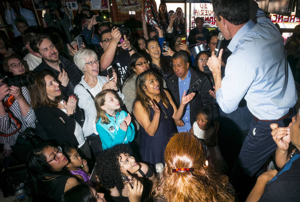 Democratic presidential candidate and former Texas congressman Beto O'Rourke, right, speaks during a campaign stop at Arandas Taqueria in Las Vegas on Sunday, March 24, 2019. (Chase Stevens/Las Ve ...