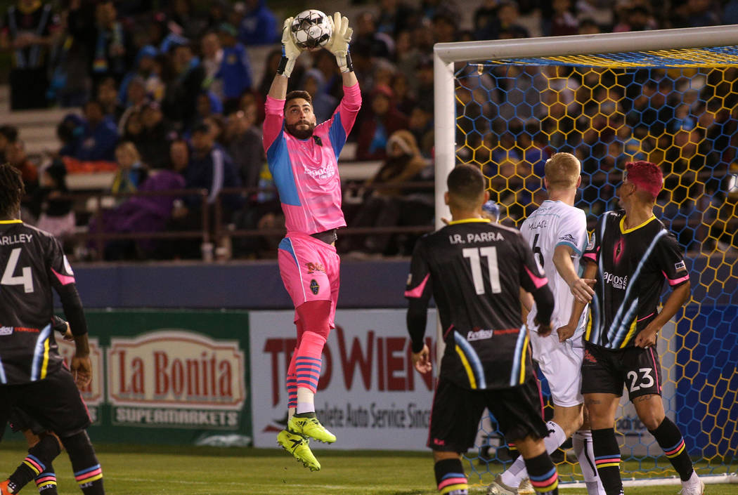 Las Vegas Lights FC goalkeeper Thomas Olsen (1) catches the ball during the second half of a United Soccer League match at Cashman Field in Las Vegas, Saturday, March 9, 2019. (Caroline Brehman/La ...