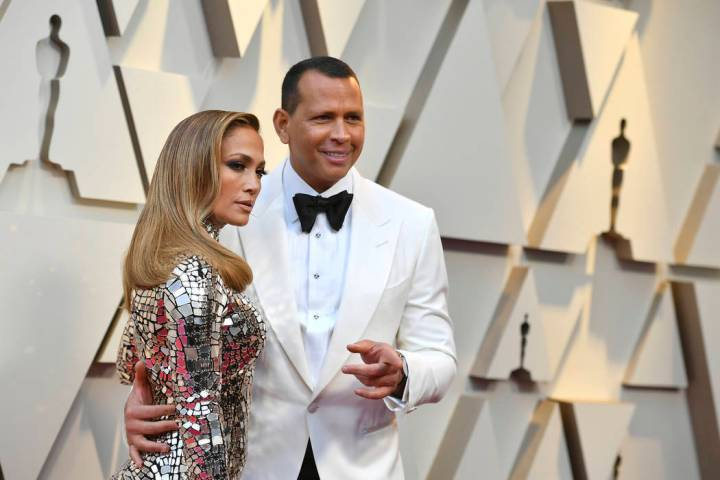 n this Feb. 24, 2019 file photo, Jennifer Lopez, left, and Alex Rodriguez arrive at the Oscars at the Dolby Theatre in Los Angeles. Barack Obama is feeling the love about the engagement of Lopez ...