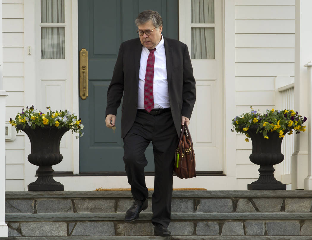 Attorney General William Barr leaves his home in McLean, Va., on Friday, March 22, 2019. Special Counsel Robert Mueller is expected to present a report to the Justice Department any day now outlin ...