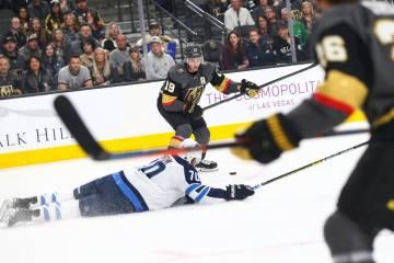 Winnipeg Jets defenseman Joe Morrow (70) falls to the ice as Golden Knights  right ca0f70079
