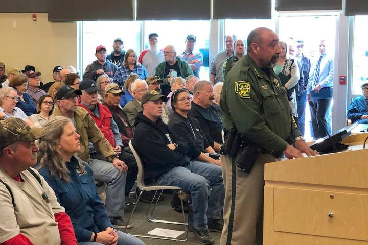 "An overflowing crowd packs the Elko County Commission chamber as Sheriff Aitor Narvaiza presents his case for the county to declare a ""Second Amendment sanctuary"" in this photo take Wednesday, Mar ..."