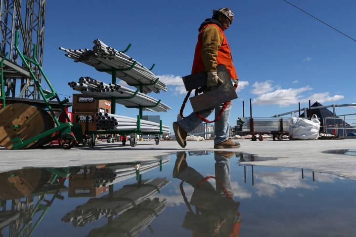 A worker carries equipment at the Raiders stadium construction site in Las Vegas, Friday, March 22, 2019. Erik Verduzco Las Vegas Review-Journal @Erik_Verduzco