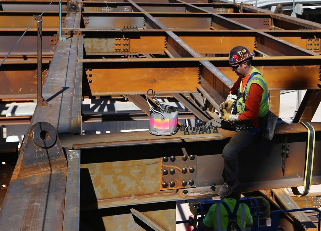 A worker installs bolts at the Raiders stadium construction site in Las Vegas, Friday, March 22, 2019. Erik Verduzco Las Vegas Review-Journal @Erik_Verduzco