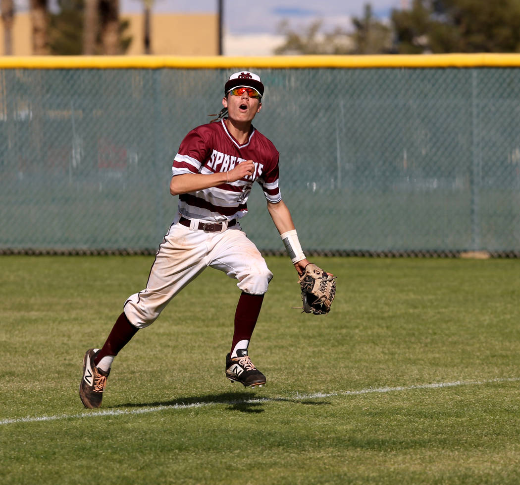 Cimarron-Memorial's Ethan Daniel (17) looks to catch a foul ball against Silverado in the third inning of their baseball game at Cimarron-Memorial High School in Las Vegas Friday, March 22, 2019. ...
