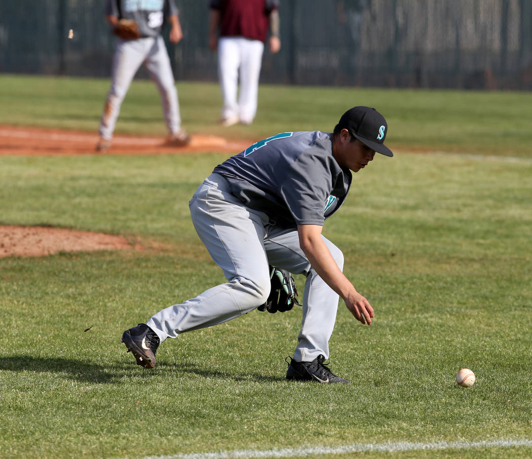 Silverado pitcher Angel Garcia (4) looks to grab a bunt against Cimarron-Memorial in the third inning of their baseball game at Cimarron-Memorial High School in Las Vegas Friday, March 22, 2019. ( ...