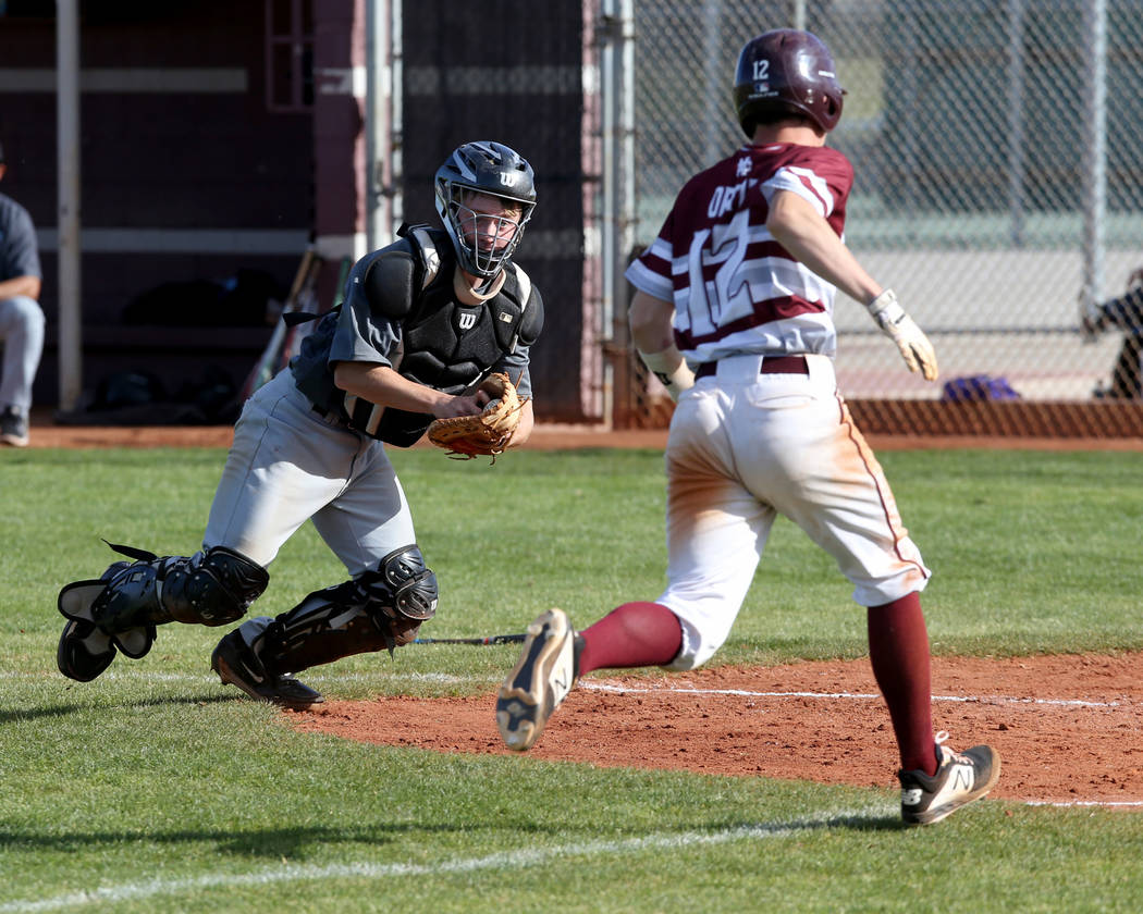 Silverado catcher Brant Hunt (18) looks to tag Cimarron-Memorial baserunner Anthony Ortiz (12) in the third inning of their baseball game at Cimarron-Memorial High School in Las Vegas Friday, Marc ...