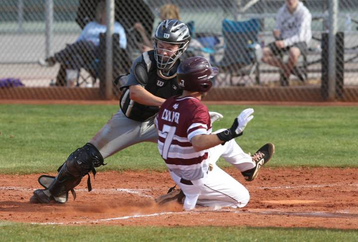 Silverado catcher Brant Hunt (18) tags out Cimarron-Memorial Zach Culver (7) at home in the third inning of their baseball game at Cimarron-Memorial High School in Las Vegas Friday, March 22, 2019 ...