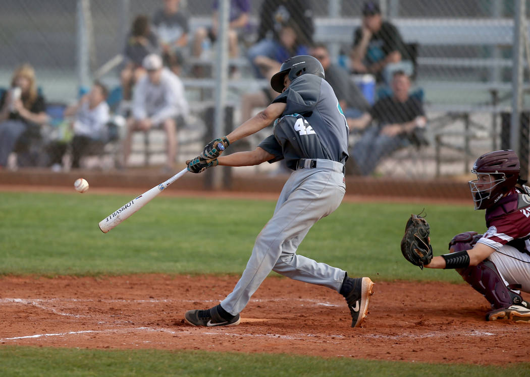 Silverado's Caleb Hubbard (42) hits against Cimarron-Memorial in the fourth inning of their baseball game at Cimarron-Memorial High School in Las Vegas Friday, March 22, 2019. (K.M. Cannon/Las Veg ...