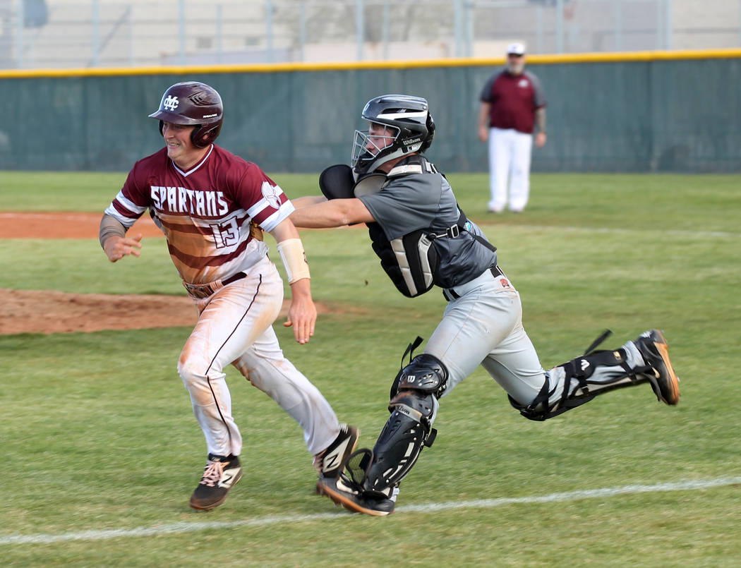 Silverado catcher Brant Hunt (18) tags out Cimarron-Memorial Lance Quaney (13) in a rundown in the fourth inning of their baseball game at Cimarron-Memorial High School in Las Vegas Friday, March ...