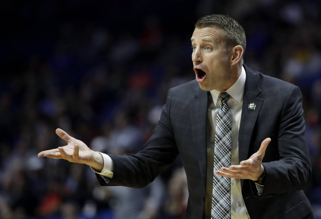 Buffalo head coach Nate Oats talks to his players during the first half of a first round men's college basketball game against Arizona State in the NCAA Tournament Friday, March 22, 2019, in Tulsa ...